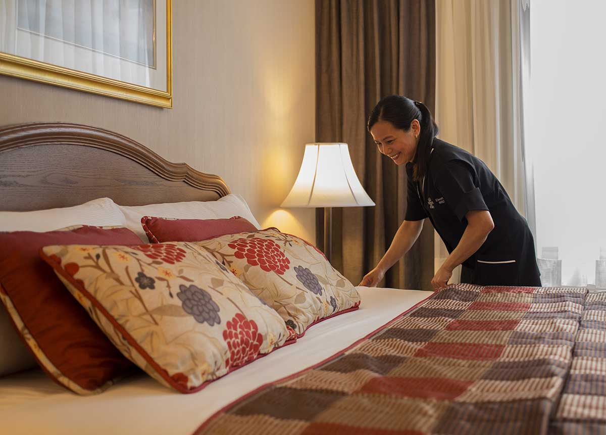 Maid cleaning room at Hotel Du Fort in Montreal